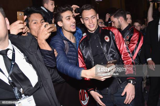 Lucas Ocampos takes selfies with fans during The New Bomber Presentation at the Diesel Store on March 14 2017 in Milan Italy