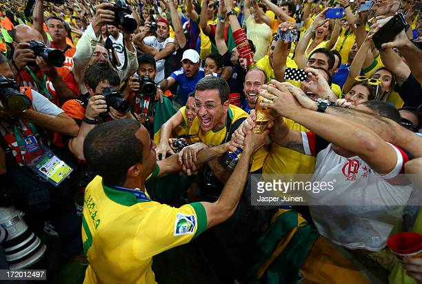Lucas of Brazil celebrates with the trophy and fans at the end of the FIFA Confederations Cup Brazil 2013 Final match between Brazil and Spain at...