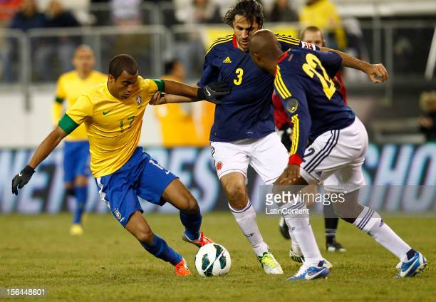 Lucas of Brazil tries to get around Mario Alberto Yepes of Colombia during a FIFA Friendly match between Colombia and Brazil at the MetLife Stadium...