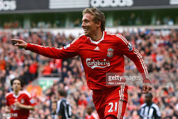 Lucas of Liverpool celebrates scoring his team's third goal during the Barclays Premier League match between Liverpool and Newcastle United at...