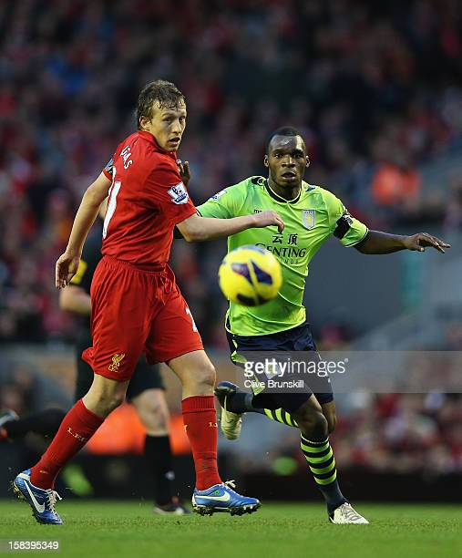Lucas of Liverpool in action with Christian Benteke of Aston Villa during the Barclays Premier League match between Liverpool and Aston Villa at...