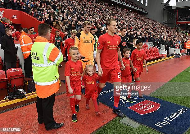 Lucas of Liverpool leads the liverpool team out for possibly for the last time at the start of the Emirates FA Cup Third Round match between...