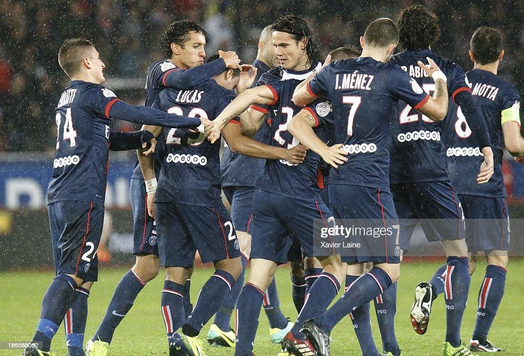 Lucas of Paris Saint-Germain celebrate his goal with Edinson Cavani and team matte during the French League 1 between Paris Saint-Germain FC and Lorient FC, at Parc des Princes on November 1, 2013 in Paris, France.