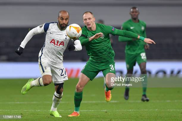 Lucas of Tottenham Hotspur and Anton Nedyalkov of Ludogorets battle for the ball during the UEFA Europa League Group J stage match between Tottenham...