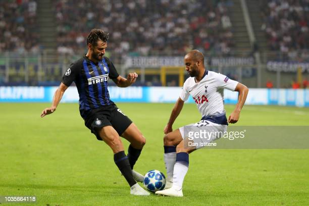 Lucas of Tottenham Hotspur battles for the ball with Antonio Candreva of Internazionale during the Group B match of the UEFA Champions League between...
