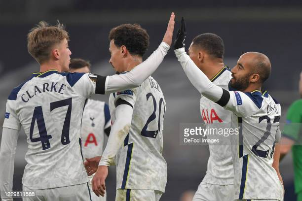 Lucas of Tottenham Hotspur celebrates after scoring his teams fourth goal with team mates during the UEFA Europa League Group J stage match between...