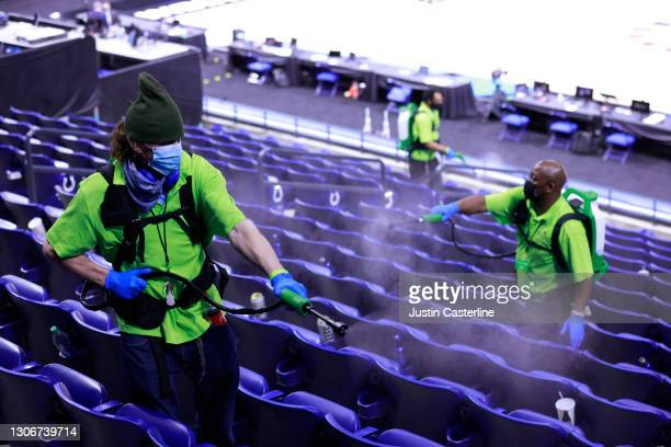 Lucas Oil Stadium employee disinfects the the seats due to Covid-19 after the game between the Purdue Boilermakers and Ohio State Buckeyes at Lucas...