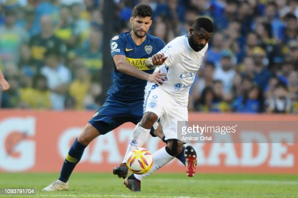 Lucas Olaza of Boca Juniors fight for the ball with Santiago Garcia of Godoy Cruz during a match between Boca Juniors and Godoy Cruz as part of...