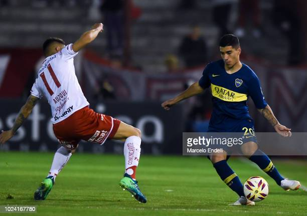 Lucas Olaza of Boca Juniors fights for the ball with Carlos Auzqui of Huracan during a match between Huracan and Boca Juniors as part of Superliga...