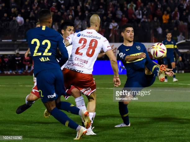 Lucas Olaza of Boca Juniors fights for the ball with Cristian Chimino of Huracan during a match between Huracan and Boca Juniors as part of Superliga...