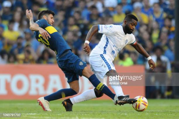 Lucas Olaza of Boca Juniors fights for the ball with Santiago Garcia of Godoy Cruz during a match between Boca Juniors and Godoy Cruz as part of...