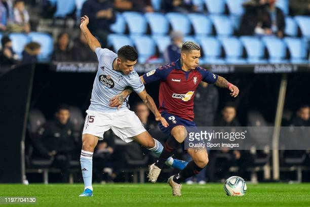 Lucas Olaza of Celta de Vigo competes for the ball with Chimy Avila of CA Osasuna during the Liga match between RC Celta de Vigo and CA Osasuna at...