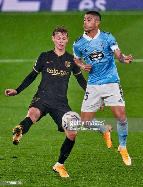 Lucas Olaza of Celta de Vigo competes for the ball with Frenkie de Jong of FC Barcelona during the La Liga Santander match between RC Celta and FC...
