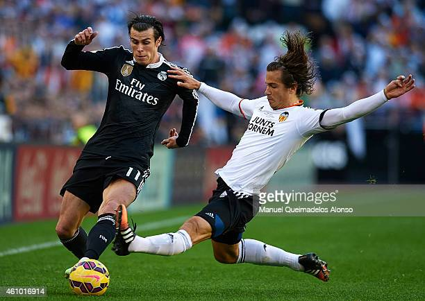 Lucas Orban of Valencia competes for the ball with Gareth Bale of Real Madrid during the La Liga match between Valencia CF and Real Madrid CF at...
