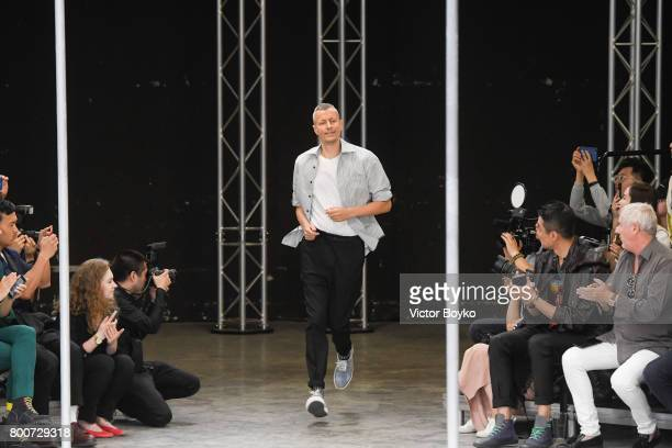 Lucas Ossendrijver walks the runway during the finale of Lanvin Menswear Spring/Summer 2018 show as part of Paris Fashion Week on June 25, 2017 in...