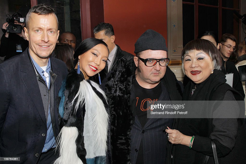 Lucas Ossendrijver, Wan Bao Bao, Alber Elbaz and Lanvin's owner, Shaw Lan Wang, pose following the Lanvin Men Autumn / Winter 2013 show at Ecole Nationale Superieure Des Beaux-Arts as part of Paris Fashion Week on January 20, 2013 in Paris, France.