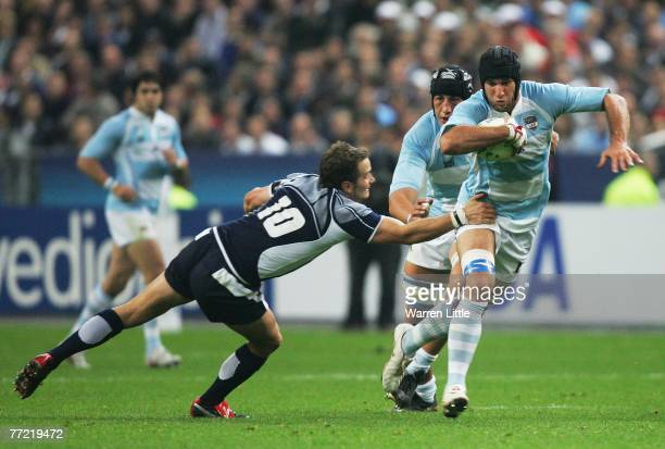 Lucas Ostiglia of Argentina goes past the challenge from Dan Parks of Scotland during the Rugby World Cup 2007 quarter final match between Argentina...