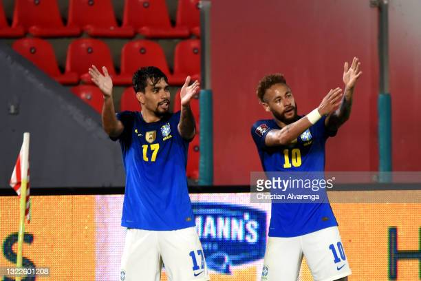 Lucas Paquetá of Brazil celebrates with teammate Neymar after scoring the second goal of his team during a match between Paraguay and Brazil as part...