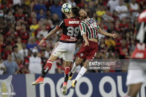 Lucas Paquetá of Flamengo battles for the ball with Gustavo Scarpa of Fluminense during the match between Flamengo and Fluminense as part of...