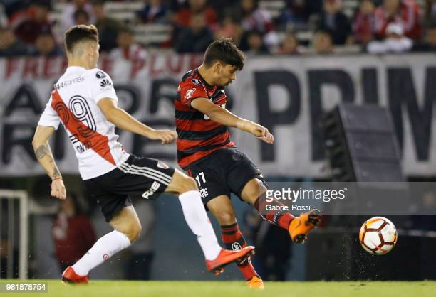 Lucas Paquetá of Flamengo kicks the ball past Gonzalo Montiel of River Plate during a match between River Plate and Flamengo as part of Copa CONMEBOL...