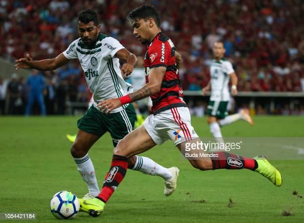 Lucas Paquetá of Flamengo struggles for the ball with Thiago Santos of Palmeiras during a match between Flamengo and Palmeiras as part of Brasileirao...
