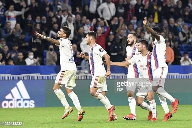 Lucas PAQUETA - 18 Rayan CHERKI - 14 Leo DUBOIS during the Ligue 1 Uber Eats match between Lyon and Troyes at Groupama Stadium on September 22, 2021...
