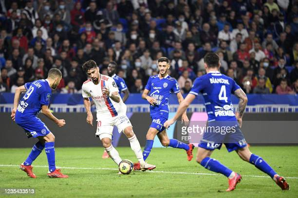 Lucas PAQUETA - 24 Xavier CHAVALERIN during the Ligue 1 Uber Eats match between Lyon and Troyes at Groupama Stadium on September 22, 2021 in Lyon,...