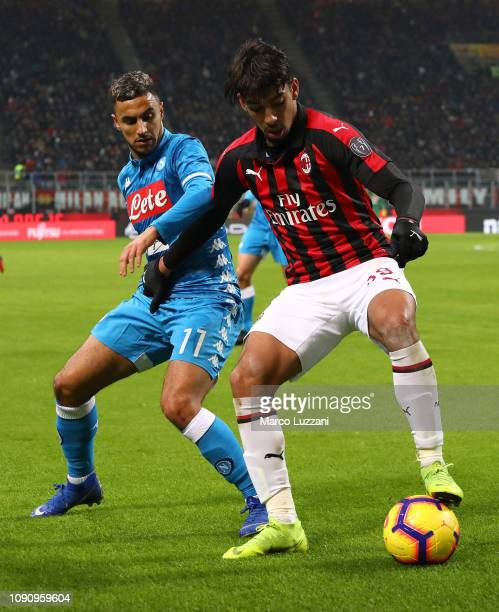 Lucas Paqueta of AC Milan competes for the ball with Adam Ounas of SSC Napoli during the Coppa Italia match between AC Milan and SSC Napoli at Stadio...