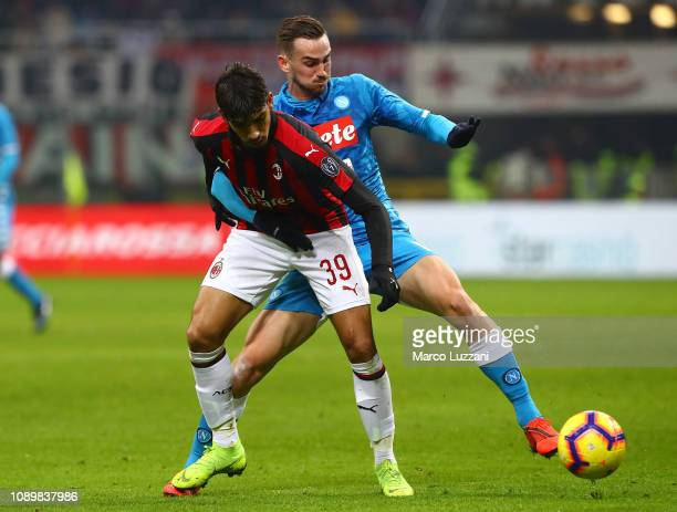 Lucas Paqueta of AC Milan competes for the ball with Fabian Ruiz of SSC Napoli during the Serie A match between AC Milan and SSC Napoli at Stadio...