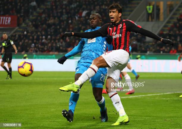 Lucas Paqueta of AC Milan competes for the ball with Kalidou Koulibaly of SSC Napoli during the Coppa Italia match between AC Milan and SSC Napoli at...