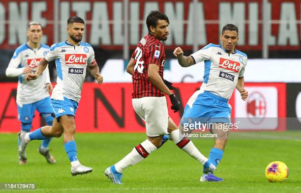 Lucas Paqueta of AC Milan competes for the ball with Marques Loureiro Allan of SSC Napoli during the Serie A match between AC Milan and SSC Napoli at...