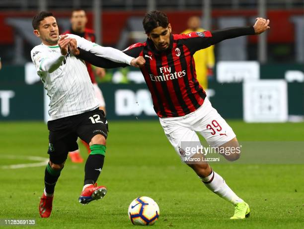 Lucas Paqueta of AC Milan competes for the ball with Stefano Sensi of US Sassuolo during the Serie A match between AC Milan and US Sassuolo at Stadio...