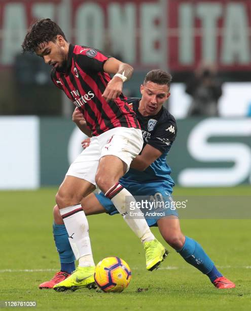 Lucas Paqueta of AC Milan is challenged by Ismael Bennacer of Empoli FC during the Serie A match between AC Milan and Empoli at Stadio Giuseppe...