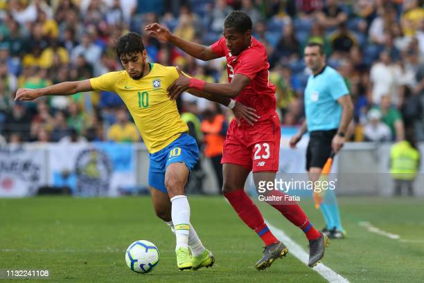 Lucas Paqueta of Brazil and AC Milan with Michael Murillo of Panama in action during the International Friendly match between Brazil and Panama at...