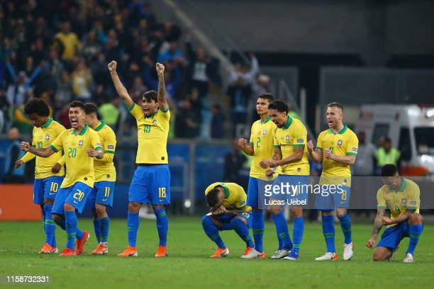 Lucas Paqueta of Brazil and teammates celebrate a penalty during the shootout after the Copa America Brazil 2019 quarterfinal match between Brazil...