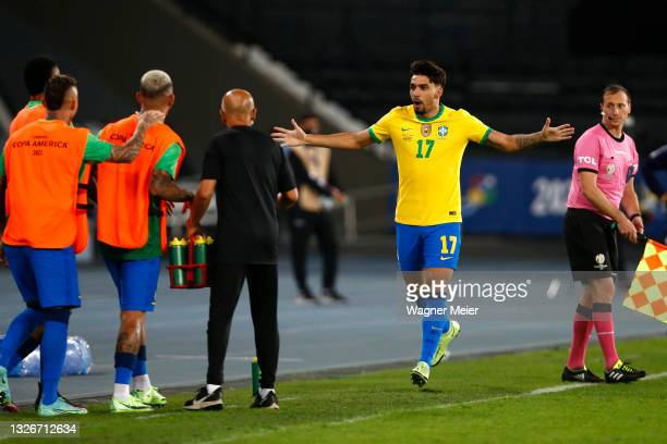 Lucas Paqueta of Brazil celebrates with teammates after scoring the first goal of his team during a quarterfinal match between Brazil and Chile as...