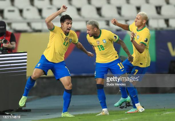 Lucas Paqueta of Brazil celebrates with teammates Neymar Jr. And Richarlison after scoring the first goal of his team during a semi-final match of...