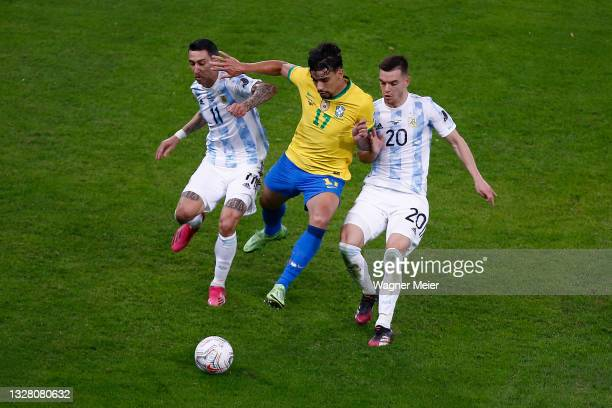 Lucas Paqueta of Brazil fights for the ball with Angel Di Maria and Giovani Lo Celso of Argentina during the final of Copa America Brazil 2021...