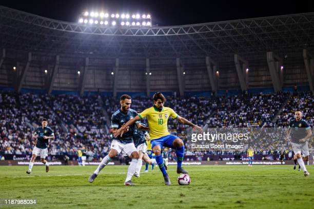 Lucas Paqueta of Brazil fights for the ball with German Pezzella of Argentina during the international friendly match between Brazil and Argentina at...