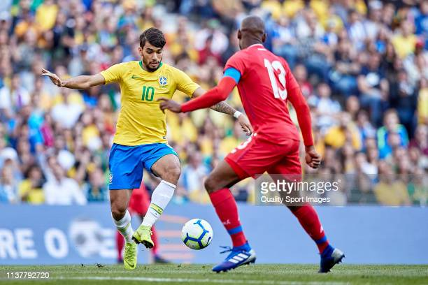 Lucas Paqueta of Brazil is challenged by Adolfo Machado of Panama during the International Friendly match between Brazil and Panama at Estadio do...