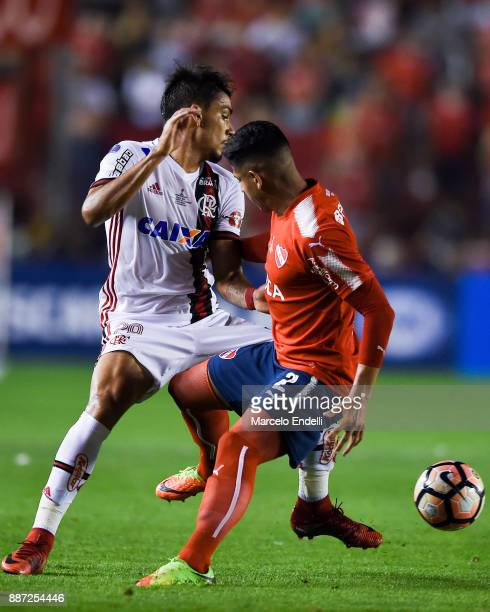 Lucas Paqueta of Flamengo fights for ball with Alan Javier Franco of Independiente during the first leg of the Copa Sudamericana 2017 final between...