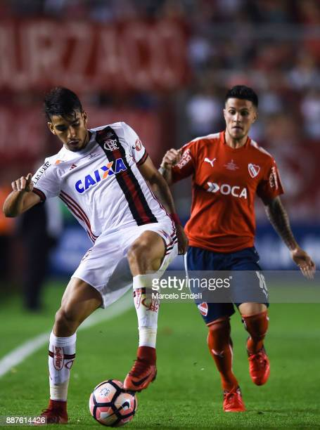 Lucas Paqueta of Flamengo fights for ball with Fabricio Bustos of Independiente during the first leg of the Copa Sudamericana 2017 final between...
