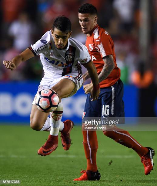Lucas Paqueta of Flamengo fights for ball with Fabricio Bustos of Indendiente during the first leg of the Copa Sudamericana 2017 final between...