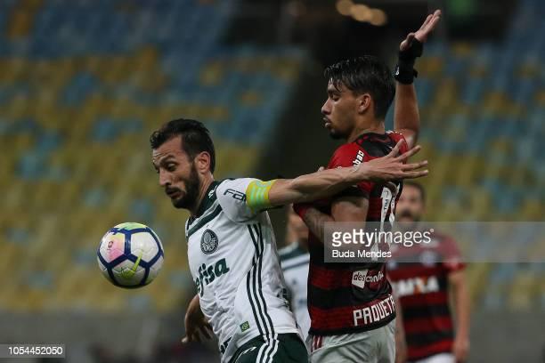 Lucas Paqueta of Flamengo struggles for the ball with Edu Dracena of Palmeiras during a match between Flamengo and Palmeiras as part of Brasileirao...