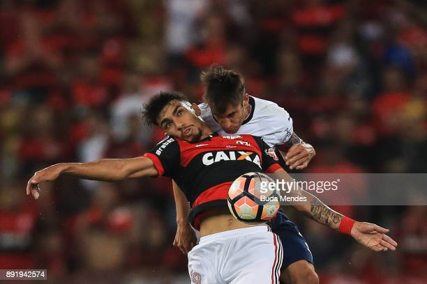 Lucas Paqueta of Flamengo struggles for the ball with Nicolas Tagliafico of Independiente during the second leg of the Copa Sudamericana 2017 final...