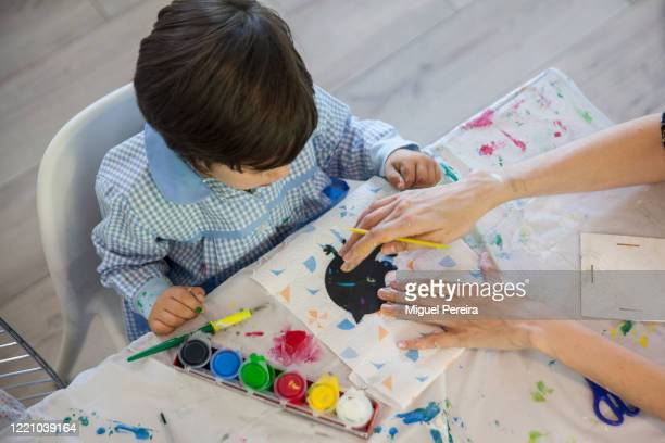 Lucas Pereira son of the photographer doing crafts at his home on April 25 2020 in Majadahonda Madrid Spain Starting last week some businesses deemed...