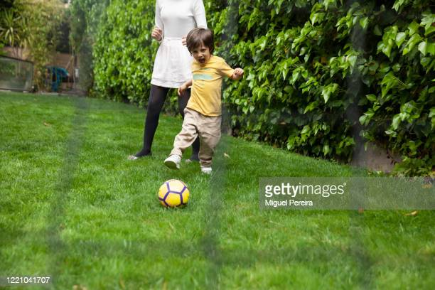 Lucas Pereira, son of the photographer, playing football at the garden of his home on April 25, 2020 in Majadahonda, Madrid, Spain. Starting last...