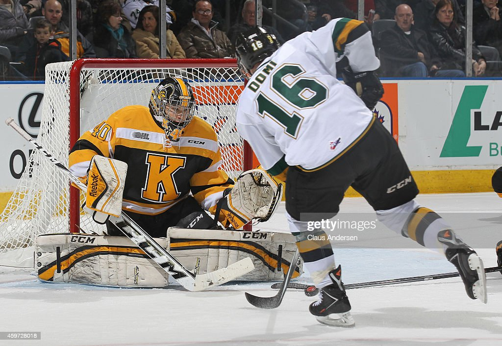 Lucas Peressini #40 of the Kingston Frontenacs stops a scoring attempt by Max Domi #16 of the London Knights in an OHL game at Budweiser Gardens on November 29, 2014 in London, Ontario, Canada. The Frontenacs defeated the Knights 3-2 in an overtime shoot-out.