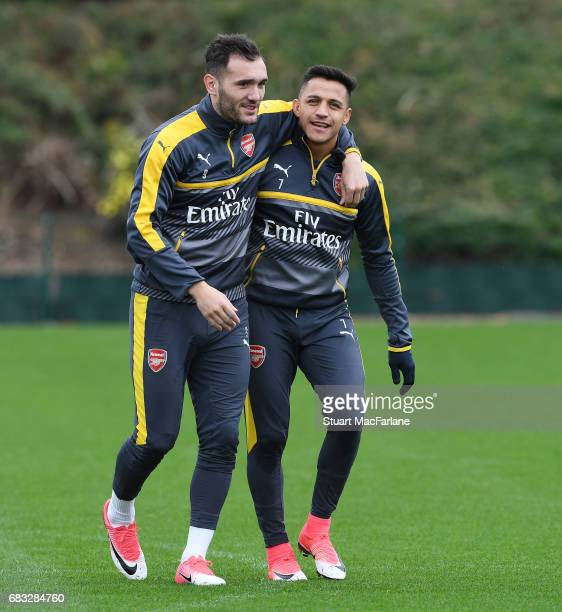 Lucas Perez and Alexis Sanchez of Arsenal during a training session at London Colney on May 15 2017 in St Albans England