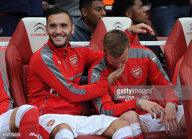 Lucas Perez and Rob Holding of Arsenal before the Premier League match between Arsenal and Chelsea at Emirates Stadium on September 24 2016 in London...